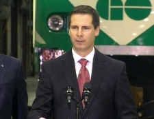 Ontario Premier Dalton McGuinty makes the public transit announcement at at GO Transit yard in Etobicoke, west-end Toronto, Tuesday, Feb. 17, 2009.