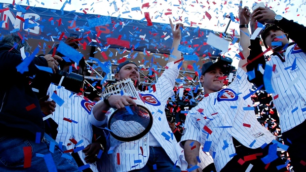 Chicago Cubs' Jon Lester holds the Commissioners Trophy as he celebrates with teammates during a celebration honoring the World Series champions at Grant Park in Chicago, Friday, Nov. 4, 2016. (AP / Nam Y. Huh)