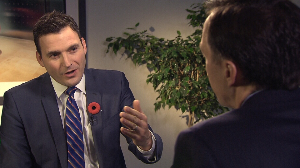 Evan Solomon, host of CTV's Power Play questions Finance Minister Bill Moreneau during an interview, Sunday, Nov. 6, 2016.