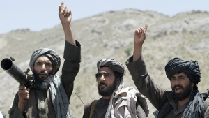 In this May 27, 2016 file photo, Taliban fighters react to a speech by their senior leader in the Shindand district of Herat province, Afghanistan. (AP / Allauddin Khan, File)