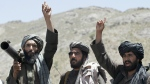 Taliban fighters react to a speech by their senior leader in the Shindand district of Herat province, Afghanistan on May 27, 2016. (AP / Allauddin Khan)