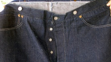 This undated photo provided by Daniel Buck Auctions & Appraisals shows the front of a pair of 1893 Levi-Strauss denim blue jeans in pristine condition that will go up for auction Saturday, Nov. 5, 2016 in Lisbon Falls, Maine. (Daniel Buck Soules/Daniel Buck Auctions & Appraisals via AP)