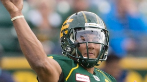 Edmonton Eskimos quarterback James Franklin (2) makes the throw against the Toronto Argonauts during first half CFL action in Edmonton, Alta., on Saturday November 5, 2016.  (Jason Franson/The Canadian Press)