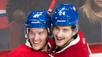 Montreal Canadiens' Phillip Danault, right, celebrates with teammate Torrey Mitchell after scoring against the Philadelphia Flyers during third period NHL hockey action in Montreal, Saturday, November 5, 2016. (THE CANADIAN PRESS / Graham Hughes)