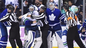 Vancouver Canucks goalie Ryan Miller (30) and Toronto Maple Leafs goalie Frederik Andersen (31) take part in a line brawl during third period NHL hockey action in Toronto on Saturday, November 5, 2016. (THE CANADIAN PRESS / Frank Gunn)