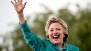 Democratic presidential candidate Hillary Clinton waves as she cuts her speech short due to rain at a rally at C.B. Smith Park in Pembroke Pines, Fla., Saturday, Nov. 5, 2016. THE CANADIAN PRESS/AP, Andrew Harnik