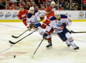 Edmonton Oilers center Anton Lander (51) of Sweden goes for the puck against Detroit Red Wings left wing Henrik Zetterberg (40) of Sweden during the first period of an NHL hockey game in Detroit, Sunday, Nov. 6, 2016. (AP Photo/Jose Juarez)