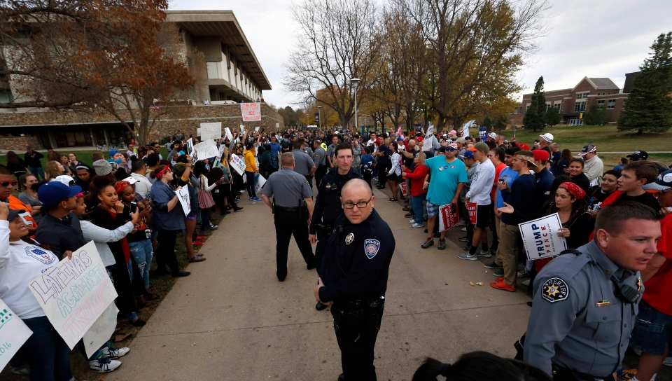Police stand between anti-Trump protesters, left, and Trump supporters, following a speech and rally with Republican presidential candidate Donald Trump, at the University of Northern Colorado, in Greeley, Colo., Sunday, Oct. 30, 2016. (AP / Brennan Linsley)