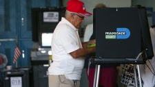 Roberto Alfonso casts his vote in Florida