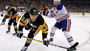 Edmonton Oilers' Adam Larsson (6) checks Pittsburgh Penguins' Conor Sheary (43) off the puck during the second period of an NHL hockey game in Pittsburgh, Tuesday, Nov. 8, 2016. (AP Photo / Gene J. Puskar)