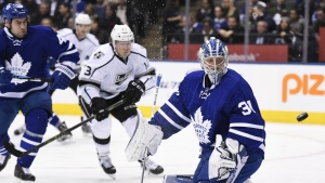 Toronto Maple Leafs goalie Frederik Andersen watches the puck sail wide as Los Angeles Kings centre Tyler Toffoli and Toronto Maple Leafs defenceman Roman Polak battle during first period NHL hockey action in Toronto on Tuesday, Nov. 8, 2016. (Frank Gunn / THE CANADIAN PRESS)
