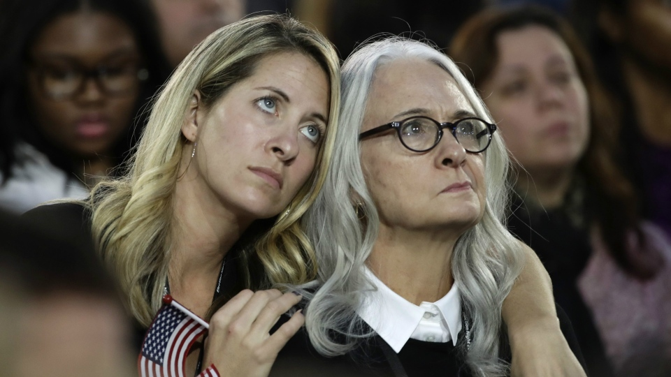 Women watch election results during Democratic presidential nominee Hillary Clinton's election night rally in the Jacob Javits Center glass enclosed lobby in New York, Tuesday, Nov. 8, 2016. (AP / Frank Franklin II)