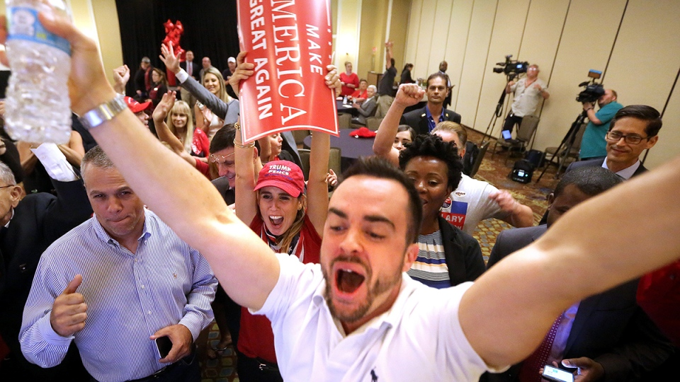 Trump supporters react as Fox News predicts Republican presidential candidate Donald Trump will carry Florida, at the Republican Party of Seminole County, Fla., election watch event in Altamonte Springs, near Orlando, Fla., Tuesday, Nov. 8, 2016. (Joe Burbank / Orlando Sentinel via AP)