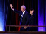 Vice-President-elect Mike Pence and his wife Karen Pence waves as they arrive during his election night rally, Wednesday, Nov. 9, 2016, in New York. (AP Photo/John Locher)