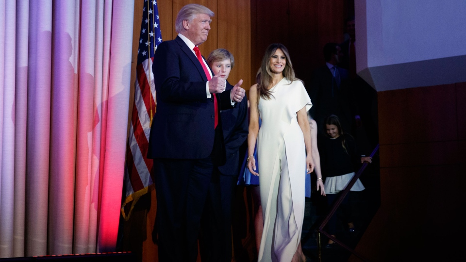 President-elect Donald Trump gives a thumbs up as he arrives to speak to an election night rally, Wednesday, Nov. 9, 2016, in New York. From left, Trump, his son Barron Trump, and wife Melania Trump. (AP Photo/ Evan Vucci)