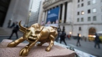 "A miniature reproduction of Arturo Di Modica's ""Charging Bull"" sculpture sits on display at a street vendor's table outside the New York Stock Exchange, in lower Manhattan on Tuesday, Oct. 25, 2016. (Mary Altaffer/AP)"