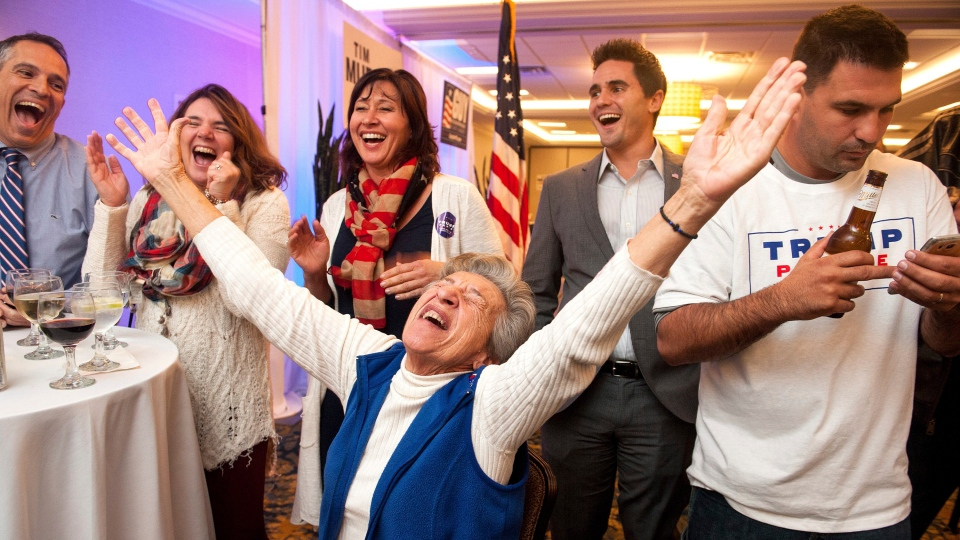 GOP supporter Georgia Touloumes, center, 86, of Venetia, Pa., shouts in joy surrounded by her family as more states are announced for Republican presidential candidate Donald Trump at the Crowne Plaza in Bethel Park, a suburb of Pittsburgh on Tuesday, Nov. 8, 2016. (Stephanie Strasburg / Pittsburgh Post-Gazette via AP)