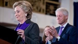 Democratic presidential candidate Hillary Clinton, left, accompanied by her husband former President Bill Clinton, right, finishes speaking at the New Yorker Hotel in New York, Wednesday, Nov. 9, 2016, where she conceded her defeat to Republican Donald Trump after the hard-fought presidential election. (AP Photo/Andrew Harnik)
