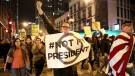 Protesters march North on State Street to express their disapproval of the election of Donald Trump as the 45th president of the United States, Wednesday, Nov. 9, 2016 in Chicago. (Armando L. Sanchez/Chicago Tribune via AP)