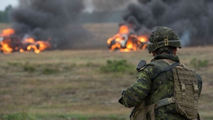 A Canadian soldier opens fire on his targets during an ambush training scenario at the Drawsko Pomorskie Training Area in Poland on August 4, 2016 during Operation Reassurance. (Canadian Armed Forces)