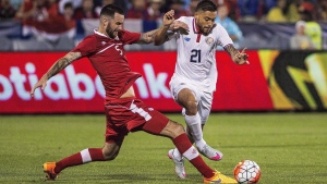 David Edgar (left) of Canada battles for the ball against David Ramirez of Costa Rica during the CONCACAF Gold Cup soccer action in Toronto on July 14, 2015. Marcel de Jong and Edgar headline Canada's men's soccer roster for a Nov. 11 friendly against South Korea. (THE CANADIAN PRESS/Aaron Vincent Elkaim)