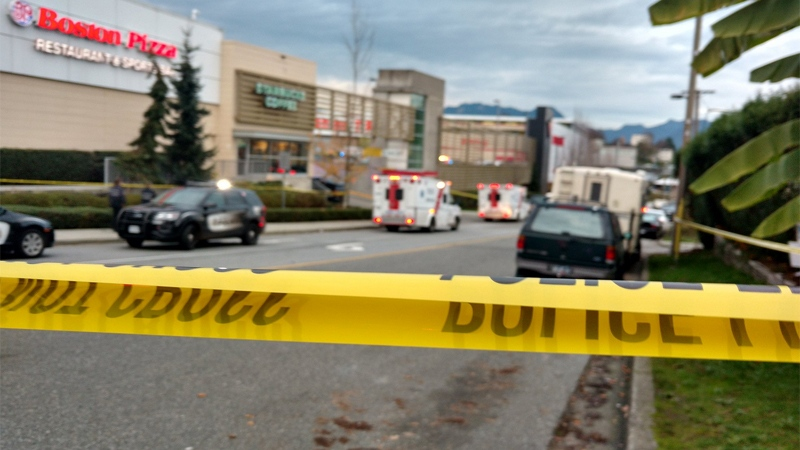 Police tape blocks the scene of a double-stabbing and hostage taking at a Canadian Tire in East Vancouver. Nov. 10, 2016. (CTV/Ben Miljure)