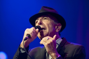 In this picture made available Friday, July 5, 2013, Canadian singer Leonard Cohen performs on the Auditorium Stravinski during the first day of the 47th Montreux Jazz Festival, in Montreux, Switzerland, Thursday, July 4, 2013. (AP / Keystone, Sandro Campardo)
