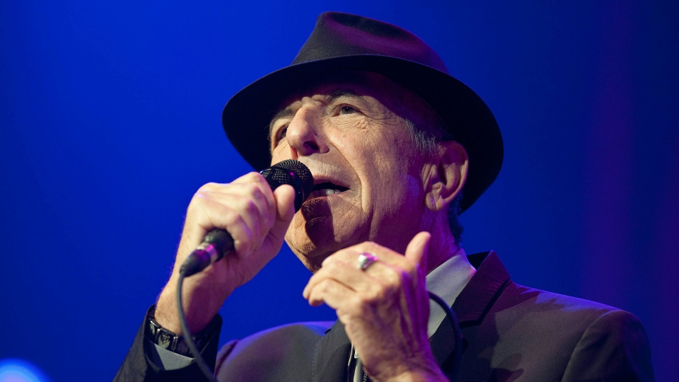 In this picture made available Friday, July 5, 2013, US singer Leonard Cohen performs on the Auditorium Stravinski during the first day of the 47th Montreux Jazz Festival, in Montreux, Switzerland, Thursday, July 4, 2013. (AP / Keystone, Sandro Campardo)