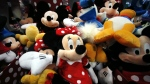 Plush Disney characters are seen piled up in a display at a Disney Store in Saugus, Mass. on Jan. 31, 2014. (AP / Elise Amendola)