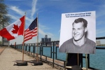 A photo of hockey great Gordie Howe was unveiled at the announcement that the Detroit River International Crossing will be named the Gordie Howe International Bridge, on the waterfront, in Windsor, Ont., Thursday May 14, 2015. THE CANADIAN PRESS/Dave Chidley