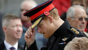Prince Harry leaves the official opening of the annual Field of Remembrance at Westminster Abbey in London, Thursday, Nov. 10, 2016. (AP Photo/Matt Dunham)