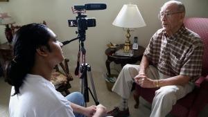 This Oct. 17, 2016 photo Rishi Sharma interviews World War II veteran William Hahn, at his home in Los Angeles. (AP Photo/Nick Ut)