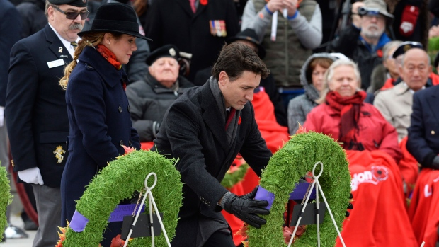 Prime Minister Justin Trudeau lays a wreath as Sophie Gregoire Trudeau looks on as they take part in the National Remembrance Day Ceremony at the National War Memorial in Ottawa on Friday Nov. 11, 2016. (THE CANADIAN PRESS/Adrian Wyld)