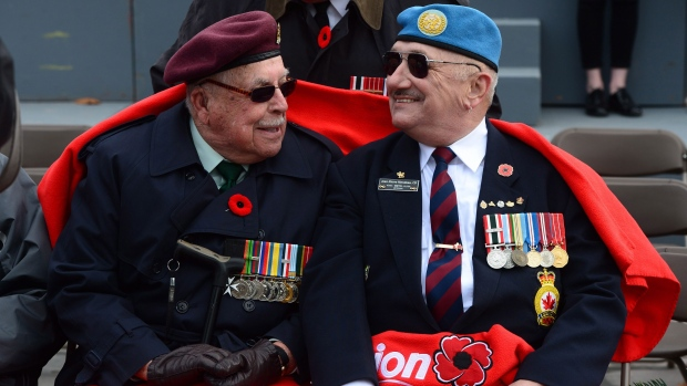 Veterans parade during a Remembrance Day ceremony Friday, November 11, 2016 in Quebec City. THE CANADIAN PRESS/Jacques Boissinot