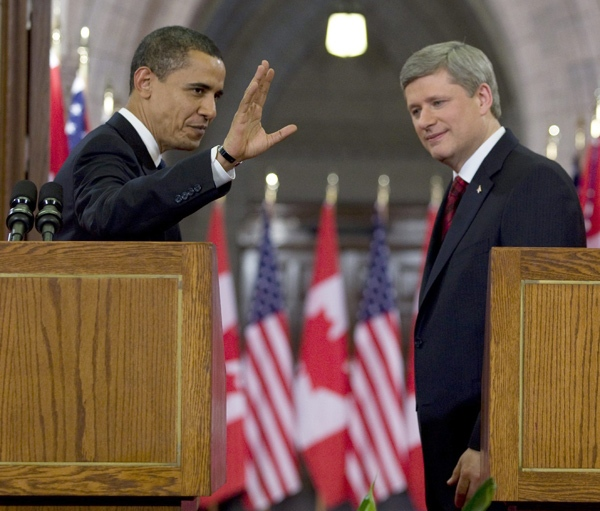 U.S. President Barack Obama waves to the media as he and Prime Minister Stephen Harper leave a joint news conference on Parliament Hill in Ottawa, Thursday, Feb. 19, 2009. (Fred Chartrand / THE CANADIAN PRESS)