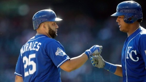 Kansas City Royals designated hitter Kendrys Morales, left, is congratulated by teammate Salvador Perez after scoring on his solo home run in the sixth inning of a baseball game against the Detroit Tigers, Saturday, Sept. 24, 2016, in Detroit. (AP Photo / Carlos Osorio)