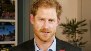 "In this grab taken from video released by Invictus Games Foundation on Saturday, Nov. 12, 2016, Britain's Prince Harry delivers a video message. Prince Harry says Sydney will host the 2018 Invictus Games and is urging wounded military athletes to ""bring it."" (Invictus Games Foundation via AP)"