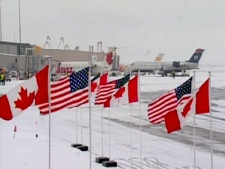 Canadian and American flags line the tarmac at the Ottawa airport, in anticipation of U.S. President Barack Obama's visit to the city, on Thursday, Feb. 19, 2009.
