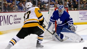 Pittsburgh Penguins' Sidney Crosby (87) has a shot blocked by Toronto Maple Leafs goalie Frederik Andersen (31) in the second period of an NHL hockey game in Pittsburgh, Saturday, Nov. 12, 2016. (AP Photo / Gene J. Puskar)