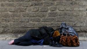 An homeless sleeps near the Vatican walls in downtown Rome, Sunday, Nov. 13, 2016. (AP Photo/Gregorio Borgia)