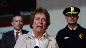 "Guilderland Police Chief Carol Lawlor speaks during a news conference outside Crossgates Mall on Saturday, Nov. 12, 2016, in Guilderland, N.Y. ""Right now we are in the process of evacuating the mall safely under our plan that we've drilled for before,"" Lawlar told Time Warner Cable News Service. (AP Photo/Mike Groll)"