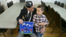 Young boy bonds with veteran