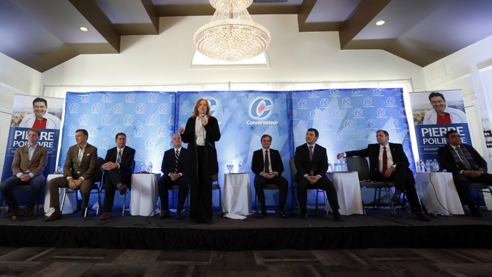Conservative leadership candidate Lisa Rait, centre, responds to questions from the audience at a Conservative leadership debate in Greely, Ont., on Sunday, Nov. 13, 2016. (Fred Chartrand / THE CANADIAN PRESS