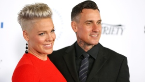 Pink, left, and Carey Hart at Barker Hangar in Santa Monica, Calif., on Oct. 8, 2015. (Rich Fury/Invision / AP)