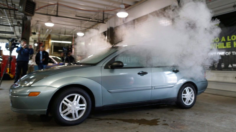 Smoke created by water vapor billows out of the windows of a car during a demonstration by the Colorado Department of Transportation in southeast Denver, on  April 16, 2015. (David Zalubowski / AP)