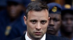 Oscar Pistorius leaves the High Court in Pretoria, South Africa after his sentencing proceedings on Wednesday, June 15, 2016. (AP / Themba Hadebe)