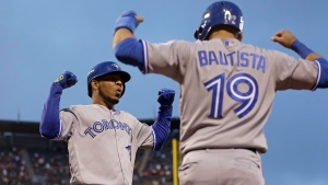 FILE - This May 9, 2016 file photo shows Toronto Blue Jays' Edwin Encarnacion, left, celebrating with Jose Bautista (19) after hitting a two run home run off San Francisco Giants' Jake Peavy in the third inning of a baseball game in San Francisco. Bautista and Encarnacion were among 10 players to receive $17.2 million qualifying offers from their teams Monday, Nov. 7, 2016. (AP Photo/Ben Margot)