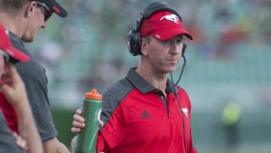 Calgary Stampeders head coach Dave Dickenson looks on as his team takes on the Saskatchewan Roughriders during the first half of CFL football action in Regina on Saturday, Aug. 13, 2016. (Rick Elvin / THE CANADIAN PRESS)