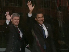 Prime Minister Stephen Harper and U.S. President Barack Obama wave to crowds gathered outside Parliament Hill in Ottawa on Thursday, Feb. 19, 2009.