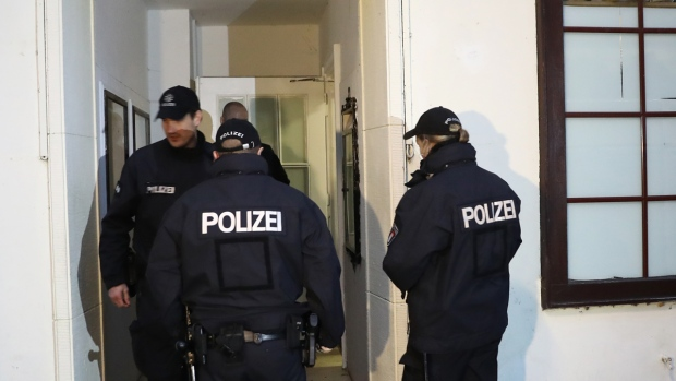 Police officers enter a mosque in Hamburg, Germany
